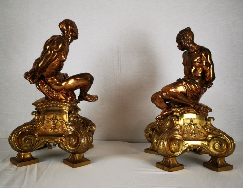 A pair of gilt-bronze slaves fire dogs, after a model by Pietro Tacca -