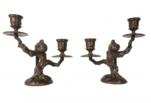 A pair of candelabra with sleeping feasants, by Antoine-Louis Barye.