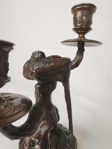 Antiquités - A pair of candelabra with sleeping feasants, by Antoine-Louis Barye.