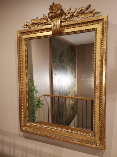 A giltwood mirror irca 1780 - Mirrors, Trumeau Style Louis XVI