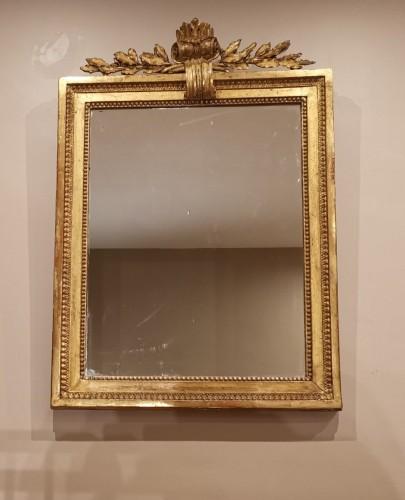 Mirrors, Trumeau  - A giltwood mirror irca 1780