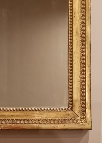 Antiquités - A giltwood mirror irca 1780