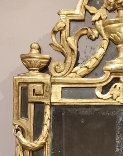 A Giltwood Louis XVI mirror -