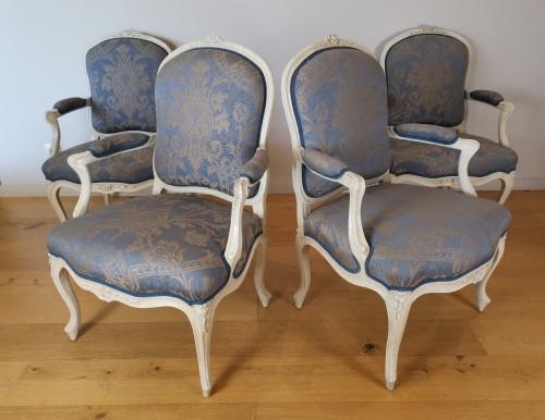A set of four Louis XV painted armchairs by Louis-Michel Lefèvre 18th cent. -
