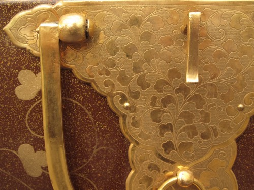 Japanese style lacquer chest, aventurine background and môn decoration -