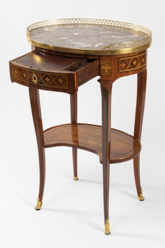 A Transitional trellis marquetery table stamped Reizell, circa 1770 -