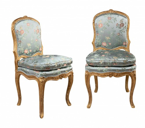 A Louis XV pair of giltwood chairs