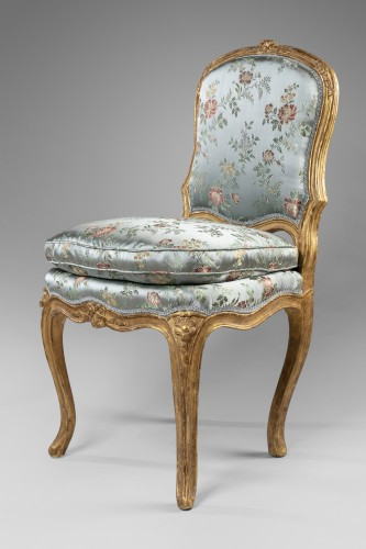 Seating  - A Louis XV pair of giltwood chairs