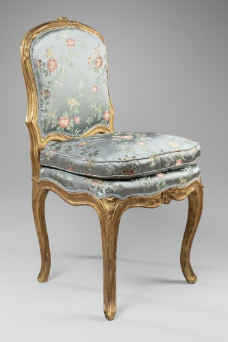 Antiquités - A Louis XV pair of giltwood chairs