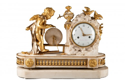 """A Louis XVI """"Cupid"""" white marble and gilt bronze clock"""