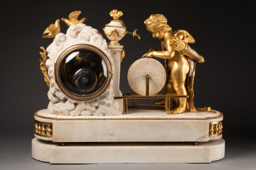 """Horology  - A Louis XVI """"Cupid"""" white marble and gilt bronze clock"""