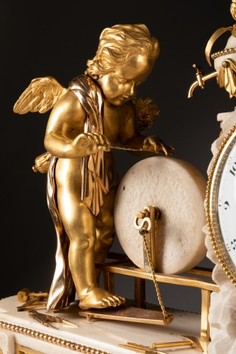 """A Louis XVI """"Cupid"""" white marble and gilt bronze clock -"""