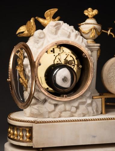 "Antiquités - A Louis XVI ""Cupid"" white marble and gilt bronze clock"