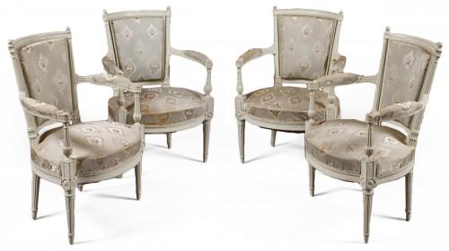 Suite of four lacquered fauteuils en cabriolet, Directoire, late 18th c.