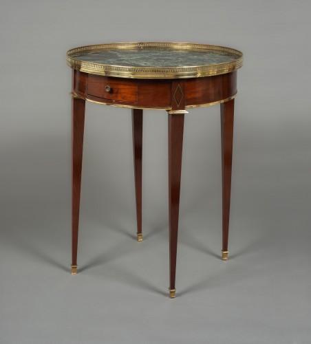 "Gilt-brass mounted mahogany guéridon ""bouillotte"" table Directoire, 18th c. -"