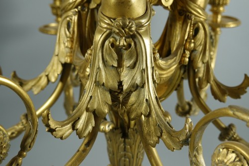 - Chandelier in gilded bronze, in the style of Pierre Gouthière