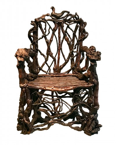 Extraordinary armchair composed of an assembly of branches of wood