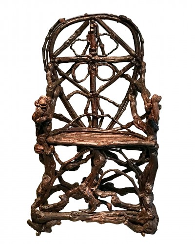 Extraordinary armchair composed of an assembly of branches of wood.