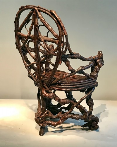 Seating  - Extraordinary armchair composed of an assembly of branches of wood.