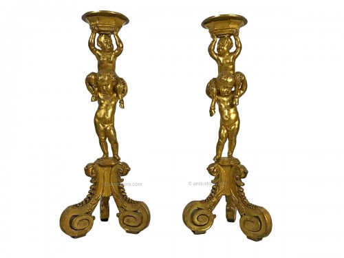 Pair of 18th century gueridons in carved and gilded wood