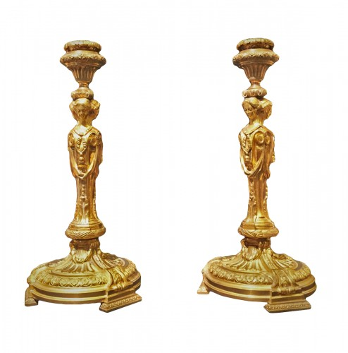 Pair of candlesticks in gilded bronze