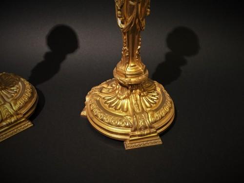 Lighting  - Pair of candlesticks in gilded bronze