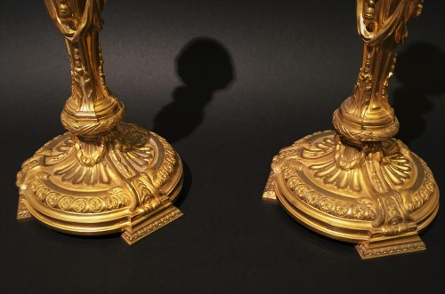 Pair of candlesticks in gilded bronze -