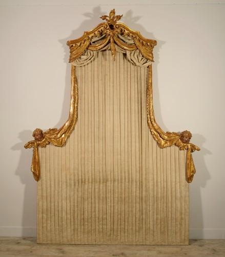 A 18th century Italian giltwood headboard