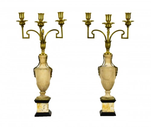 Pair of neoclassical gilt bronze and alabaster three lights candelabrum