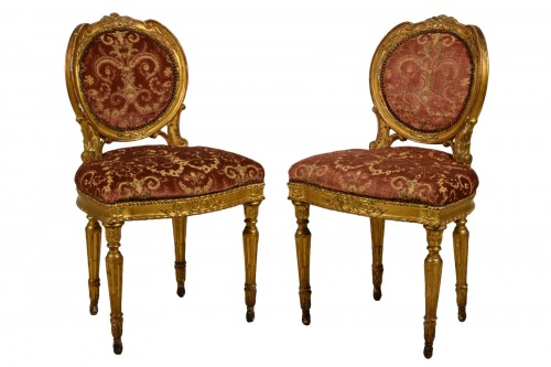 Pair of neoclassical carved and gilded wood chairs, Italy, late 18th century