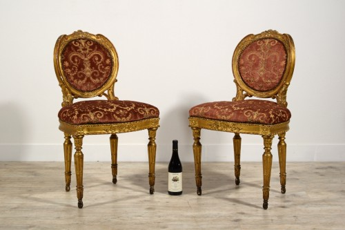 Pair of neoclassical carved and gilded wood chairs, Italy, late 18th century -