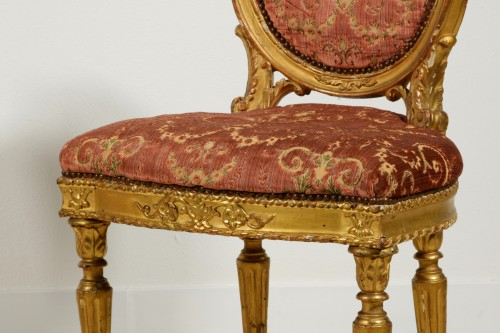 Louis XVI - Pair of neoclassical carved and gilded wood chairs, Italy, late 18th century