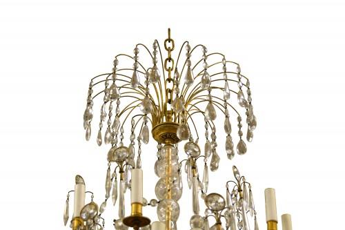 - 20th century, Gilt Bronze Crystal Louis XVI Style Chandelier
