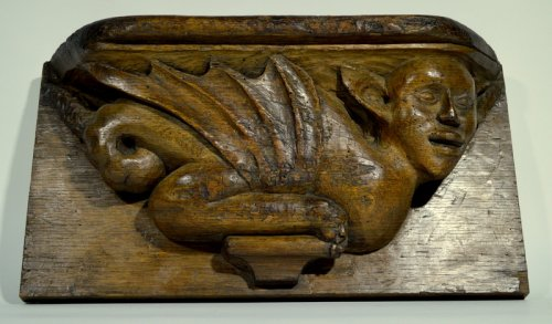 An oak misericord with devil.  northern france.  circa 1500/1520