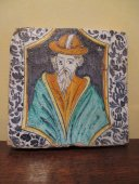 A maiolica tile with male portrait.  16th century.