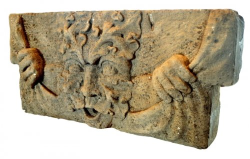 A late-Elizabethan limestone green man carving.  Late 16th century.