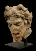 An important terra cotta head of a satyre.  17th/18th century or earlier
