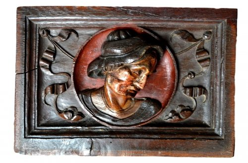 Carved oak panel showing a man's head,late 16th century.