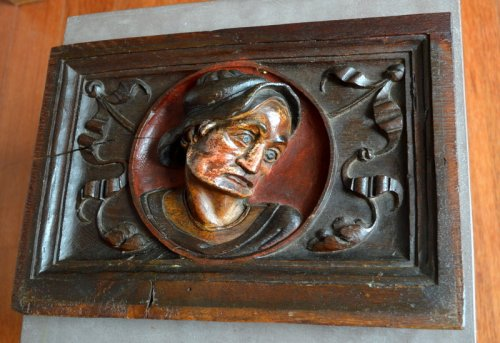Sculpture  - Carved oak panel showing a man's head,late 16th century.