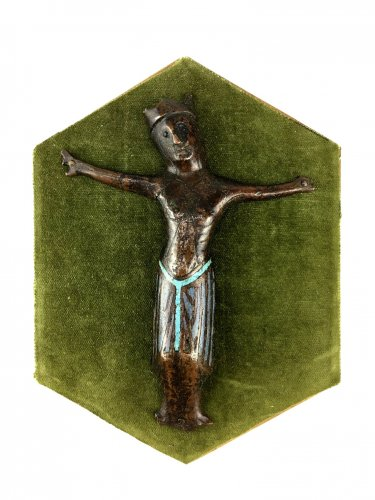 A Christ from a cross in engraved and champlevé enamel, Limoges.13th century