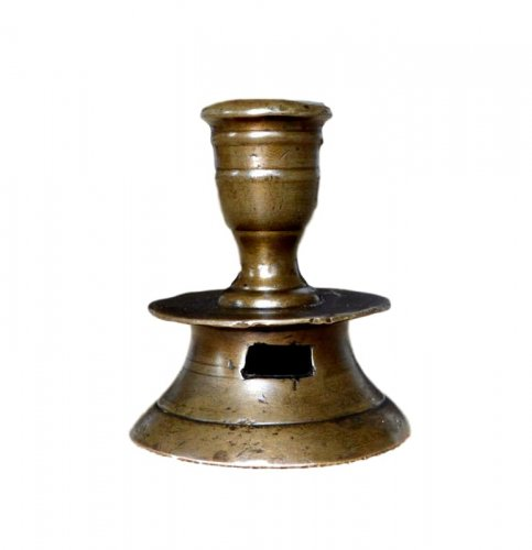 A small copper alloy travel candlestick 16th century