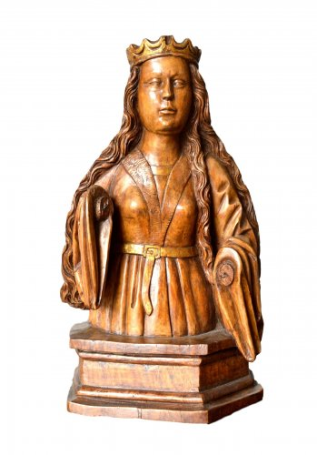 A wood carved female bust. circa 1500