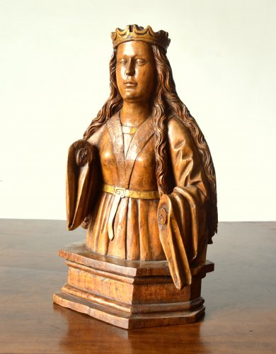 A wood carved female bust. circa 1500 -