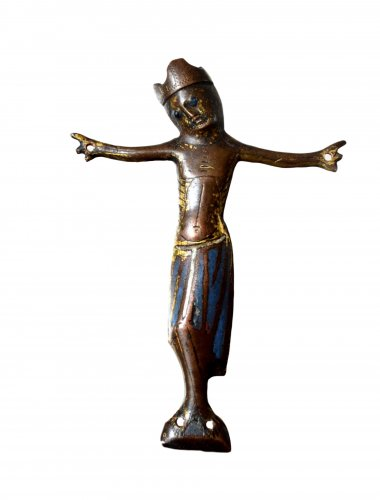 A Christ from a cross in engraved and champlevé enamel.  Limoges.13thc.