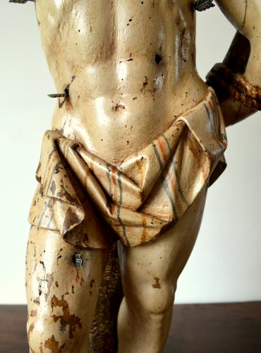 - A walnut carved sculpture of St-Sebastian.16th century