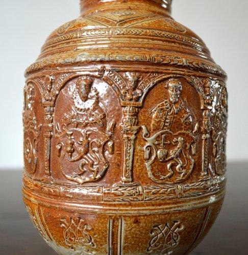 - A pewter mounted stoneware jug.Raeren 1603