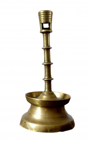 A Gothic brass Candlestick.Late 15th century.