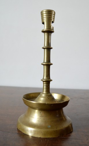 Lighting  - A Gothic brass Candlestick.Late 15th century.
