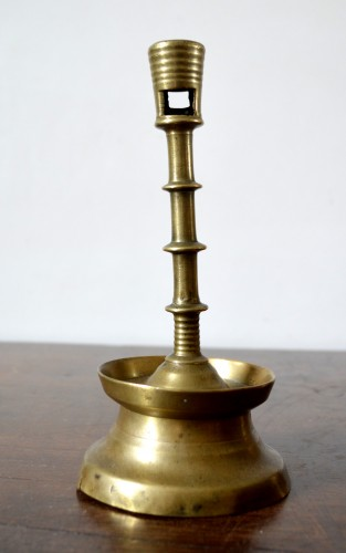 A Gothic brass Candlestick.Late 15th century. -