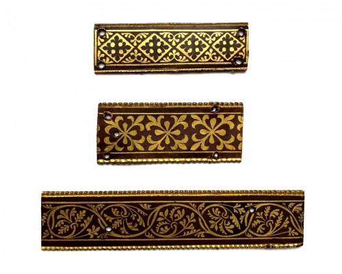A set of three gilt copper Vernis Brun plaques, Mosan 12th century